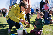 Weston Anderson, right, celebrates his Easter egg prizes with his mother, Ashley, during the 21st Annual Easter Egg Hunt at Winnequah Park in Monona, WI on Saturday, April 20, 2019.