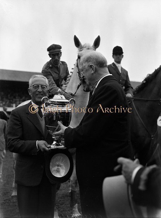 President  DeValera presents Aga Khan Cup at Horse Show..1962..10.08.1962..08.10.1962..10th August 1962..In this year's event at the RDS in Dublin, Italy were the winners of the Aga Khan Cup. Italy were victors over second place USA by a single point. The Italian team comprised of:.The Rock ridden by  Capt P d'Inzeo.Rockette ridden by G Mancinelli.Fancy Socks ridden by Dr Ugo d'Amelio.Posillipe ridden by Capt R d'Inzeo.Image shows President Eamon DeValera presenting the cup to the Italian Chef D'equipe at the RDS,Dublin. Il presidente De Valera presenta la coppa ippica AGA. Nel 1962 gli italiani furono i vincitori della gara, superando gli Stati Uniti di un solo punto.