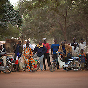 January 19, 2013 - Niono, Mali: Local residents watch a convoy of french troops arriving at Niono village, the last government controlled location before Diabaly, a city under islamist militants control since the 14th of January...Several insurgent groups have been fighting a campaign against the Malian government for independence or greater autonomy for northern Mali, an area known as Azawad. The National Movement for the Liberation of Azawad (MNLA), an organisation fighting to make Azawad an independent homeland for the Tuareg people, had taken control of the region by April 2012...The Malian government pledge to the French army to help the national troops to stop the rebellion advance towards the capital Bamako. The french troops started aerial attacks on rebel positions in the centre of the country and deployed several hundred special forces men to counter attack the advance on the ground. (Paulo Nunes dos Santos/Polaris)