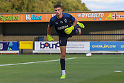 AFC Wimbledon goalkeeper Nicola Tzanev (13) warming up during the EFL Trophy (Leasing.com) match between AFC Wimbledon and U23 Brighton and Hove Albion at the Cherry Red Records Stadium, Kingston, England on 3 September 2019.