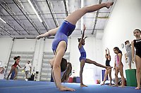 Girls attend their training session at Gravity Gymnastics, in Miramar on April 6, 2012. Photo: Cristobal Herrera