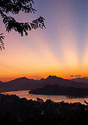 High angle view of sunset over the Mekong River and Luang Prabang, Laos, from Mount Phousi.