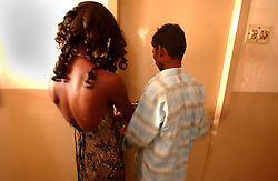 "Transgender sex worker enters a hotel room with her client in Villupuram, India. As transgenders,""hijras"" in local terms, are acutely marginalized in Indian society, the major earning avenues for them are sex work, begging and performing at rituals."