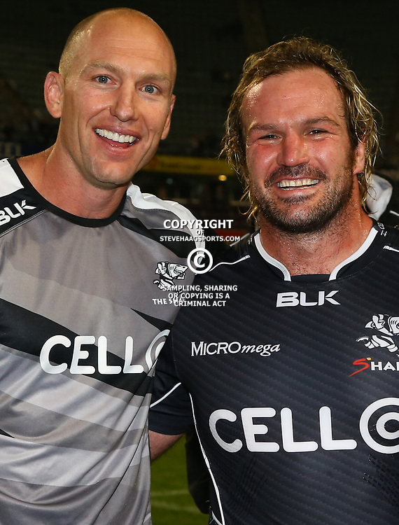 DURBAN, SOUTH AFRICA - JUNE 13: Brad MacLeod-Henderson( Assistant Coach) of the Cell C Sharks with  Jannie du Plessis of the Cell C Sharks during the Super Rugby match between Cell C Sharks and DHL Stormers at Growthpoint Kings Park on June 13, 2015 in Durban, South Africa. (Photo by Steve Haag/Gallo Images)