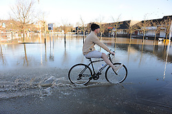 © Licensed to London News Pictures. 26/12/2013<br /> Nairn Foster (local resident) enjoying his boxing day bike ride in a flooded Sainsburys car Park in Tonbridge.<br /> Angel Lane in Tonbridge is badly flooded today (26.12.2013) with the local Sainsburys car Park totally under water.<br /> Boxing day flooding in Kent.<br /> Large parts of Kent are still flooded due to heavy rain with more bad weather expected.<br /> Photo credit :Grant Falvey/LNP