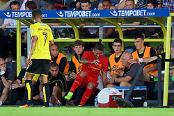 BURTON-UPON-TRENT, ENGLAND - Tuesday, August 23, 2016: Liverpool's Roberto Firmino falls on top of Burton Albion's manager Nigel Clough as he crashes into the dug-out during the Football League Cup 2nd Round match at the Pirelli Stadium. (Pic by David Rawcliffe/Propaganda)