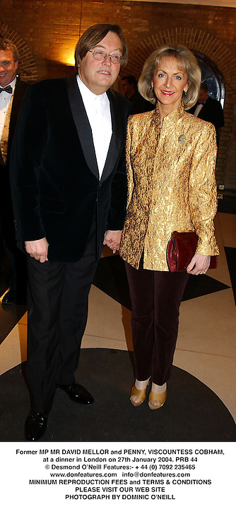 Former MP MR DAVID MELLOR and PENNY, VISCOUNTESS COBHAM, at a dinner in London on 27th January 2004.PRB 44