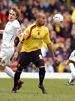 Photo: Leigh Quinnell.<br /> Watford v Luton Town. Coca Cola Championship. 09/04/2006. Watfords Marlon King takes the ball from Lutons Markus Heikkinen.