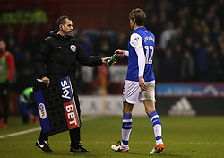 Glenn Loovens of Sheffield Wednesday hands a bottle thrown at him by a Sheffield United fan to the fourth official - Mandatory by-line: Robbie Stephenson/JMP - 12/01/2018 - FOOTBALL - Bramall Lane - Sheffield, England - Sheffield United v Sheffield Wednesday - Sky Bet Championship