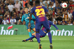 August 13, 2017 - Barcelona, Spain - Cristiano Ronaldo of Real Madrid kicks the ball to score his side's second goal during the Spanish Super Cup football match between FC Barcelona and Real Madrid on August 13, 2017 at Camp Nou stadium in Barcelona, Spain. (Credit Image: © Manuel Blondeau via ZUMA Wire)