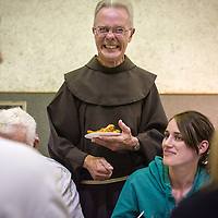 The Rev. Richard Juzix laughs as he makes his rounds through the dining hall during a fish fry supper April 1, 2011, at Sts. Simon & Jude Catholic Church in Huntington Beach, Calif.