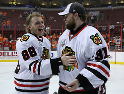 June 9, 2010; Philiadelphia, PA; USA;  Chicago Blackhawks right wing Patrick Kane (88) and Chicago Blackhawks goalie Antti Niemi (31) celebrate after the Blackhawks defeated the Flyers 4-3 in Game 6 of the Stanley Cup Finals at the Wachovia Center.
