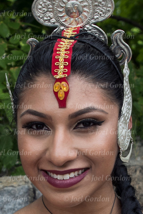 Smiling Kandysan Sri Lankan dancer showing their ethnic pride,dressed in traditional regalia.<br />