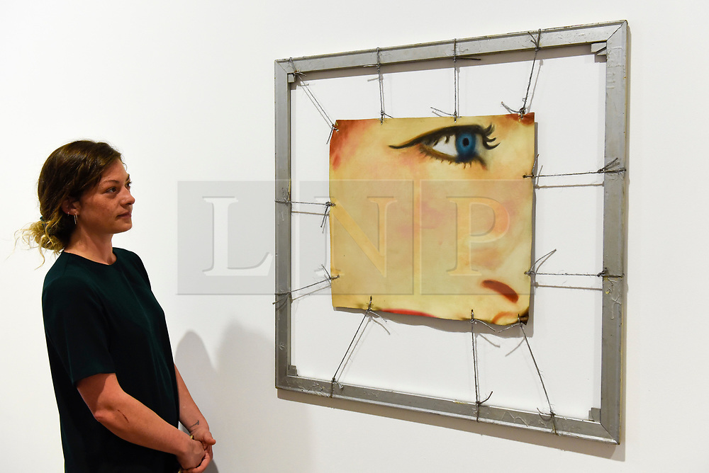 """© Licensed to London News Pictures. 10/09/2019. LONDON, UK. A staff member views """"Bedspring"""", 1962, at a preview of """"Visualising the Sixties"""", the first in depth exhibition of works by artist James Rosenquist.  From a painter of commercial billboards in New York City, to a fine art career as a Pop artist, Rosenquist's work was described as Andy Warhol's favourite.  The exhibition is on at Galerie Thaddaeus Ropac in Mayfair 10 September to 9 November.  Photo credit: Stephen Chung/LNP"""