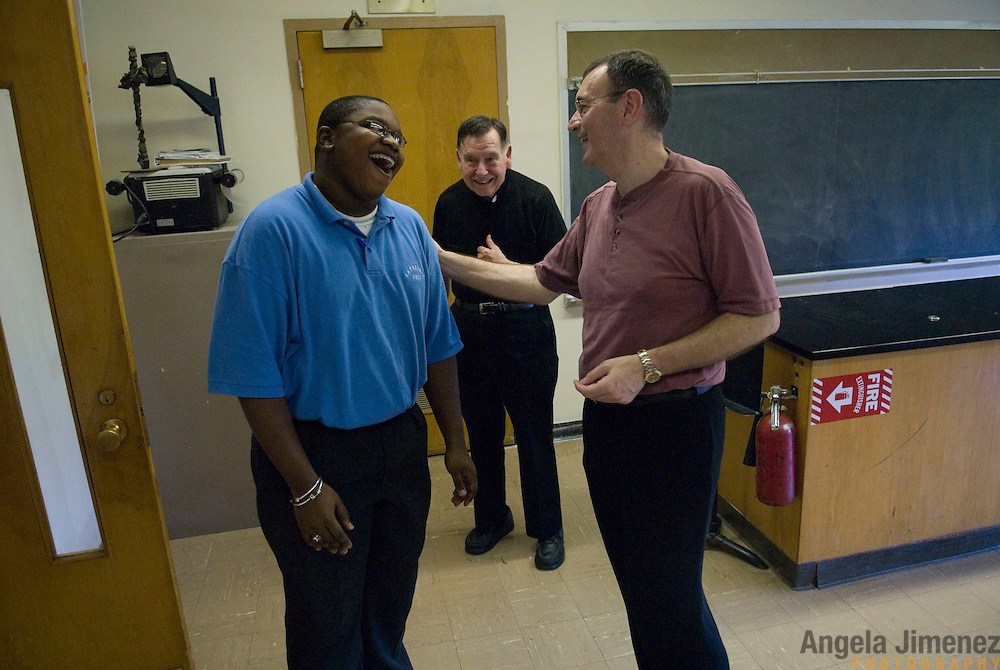 Date: 6/13/2008..Desk: MET..Slug: ..Assign Id: ....Rector-principal Monsignor Joseph Calise, right, talks with freshman student Earl Atwell in a classroom after the daily morning mass at the Cathedral Preparatory Seminary in Elmhurst, Queens on June 13, 2008. In rear is Monsignor James Cooney, the second of the three full-time priests who live and work at the school. ....Photo by Angela Jimenez for The New York Times ..photographer contact 917-586-0916