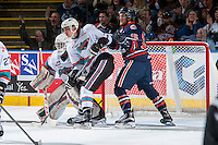 KELOWNA, CANADA - APRIL 4: Collin Shirley #15 of Kamloops Blazers stick checks Cal Foote #25 in front of the net of Michael Herringer #30 of Kelowna Rockets during first period on April 4, 2016 at Prospera Place in Kelowna, British Columbia, Canada.  (Photo by Marissa Baecker/Shoot the Breeze)  *** Local Caption *** Cal Foote; Michael Herringer; Collin Shirley;