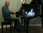 Ish and James Corothers, reflected in the baby grand piano, listen to Frank Zavaglia play every evening before dinner at Windsor Gardens, an assited-living facility.  The couple have been married for 58 years and James, a retired Bardstown judge, loves to sing, even though he's losing his memory. Frank, a retired professional musician, lives at Windsor Gardens because his wife, Ruth, has Alzheimers. 10/23/03 Julia cumes