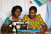Anna Nyamanda teaching another lady some of the skills she has learnt.<br /> <br /> Anna set up and now runs a tailoring business selling a variety of home furnishings in Mwanalugali, Tanzania.<br /> <br /> She attended MKUBWA enterprise training run by the Tanzania Gatsby Trust in partnership with The Cherie Blair Foundation for Women.