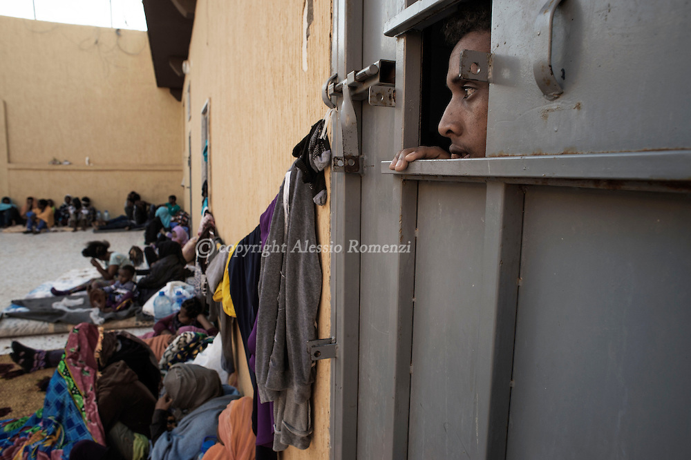 Libya, Garabulli: At Alguaiha detention center a migrant captured at the sea as he was attempting to reach Italy look outside his cell on May 12, 2015. Alessio Romenzi