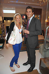 ASTRID HARBORD and THOMAS VAN STRAUBENZEE at the launch of The Rupert Lund Showroom, 61 Chelsea Manor Street, London SW3 on 2nd May 2007.<br />