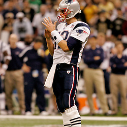 2009 November 30:  New England Patriots quarterback Tom Brady (12) takes a time out during a 38-17 win by the New Orleans Saints over the New England Patriots at the Louisiana Superdome in New Orleans, Louisiana.