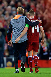 LIVERPOOL, ENGLAND - Tuesday, April 24, 2018: Liverpool's manager Jürgen Klopp and captain Jordan Henderson walk off the pitch after the 5-2 victory over AS Roma during the UEFA Champions League Semi-Final 1st Leg match between Liverpool FC and AS Roma at Anfield. (Pic by David Rawcliffe/Propaganda)