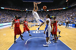 UK forward Anthony Davis, center, slams home two points in the first half. UK hosted Ole Miss Saturday, Feb. 18, 2012 at Rupp Arena in Lexington . Photo by