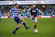 Reading defender Michael Morrison (4) pushes the ball away from Millwall forward Tom Bradshaw (9) during the EFL Sky Bet Championship match between Millwall and Reading at The Den, London, England on 18 January 2020.