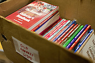 A box of older versions of Jack Smalling's book at his house in Ames, Iowa on Tuesday July 21, 2009.