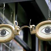 Folk Art optician - wooden eye glass sign with eyes - NYC