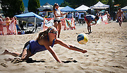 Ashley Morchant of Salt Lake City goes for a one-handed dig during Sunday's two on two Sand, Set, Spike Volleyball tournament outside Ironwood Mall in Coeur d'Alene.