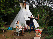 Jessie, Terence and Ben.<br /> <br /> 'WE GAVE BIRTH IN A TEPEE'.<br /> <br /> Commissioned by the GUARDIAN WEEKEND MAGAZINE. <br /> <br /> (See 'Tear sheets' gallery)