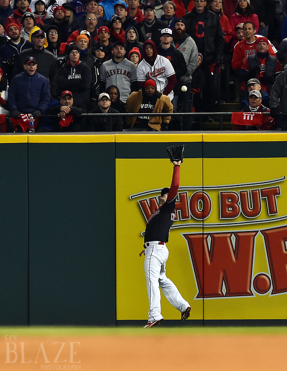 Oct 26, 2016; Cleveland, OH, USA; Cleveland Indians right fielder Lonnie Chisenhall (8) catches a fly ball by Chicago Cubs shortstop Addison Russell (not pictured) in the second inning in game two of the 2016 World Series at Progressive Field. Mandatory Credit: Ken Blaze-USA TODAY Sports