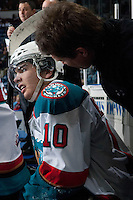 KELOWNA, CANADA - APRIL 3: Scott Hoyer, athletic therapist of the Kelowna Rockets treats Nick Merkley #10 of the Kelowna Rockets on the bench against the Seattle Thunderbirds on April 3, 2014 during Game 1 of the second round of WHL Playoffs at Prospera Place in Kelowna, British Columbia, Canada.   (Photo by Marissa Baecker/Getty Images)  *** Local Caption *** Scott Hoyer; Nick Merkley;