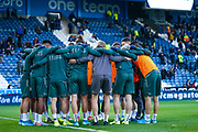 Leeds United players huddle in the warm up during the EFL Sky Bet Championship match between Huddersfield Town and Leeds United at the John Smiths Stadium, Huddersfield, England on 7 December 2019.