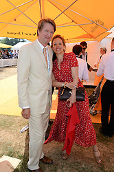 Film director TOM HOOPER and EMILIA HUNGERFORD at the Veuve Clicquot Gold Cup, Cowdray Park, Midhurst, West Sussex on 21st July 2013.
