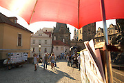 Czeck Republic - Prague, Artist stand on the Charles bridge sells painting and drawings of the area.