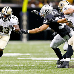 Aug 16, 2013; New Orleans, LA, USA; New Orleans Saints running back Darren Sproles (43) runs past Oakland Raiders strong safety Tyvon Branch (33) during the first quarter of a preseason game at the Mercedes-Benz Superdome. Mandatory Credit: Derick E. Hingle-USA TODAY Sports
