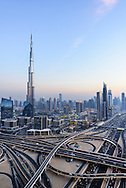 Downtown Dubai with Burj Khalifa and iSheikh Zayed Road interchange with Financial Center Road. Twilight, dusk, sunset, cityscape in United Arab Emirates.