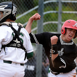 Ayala's Josh Bozoian reacts after scoring on a Daniel Ramirez (not pictured) three run double as Bonita catcher Jarret Lindsay (16) looks away in the fifth inning of a prep baseball game at Bonita High School in La Verne, Calif., Wednesday, May 6, 2015. Bonita won 7-5.