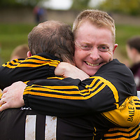 Ballyea's Manager Diarmuid O'Sullivan and player Rory Longe  celebrate their sides win in the Junior B Hurling FInal