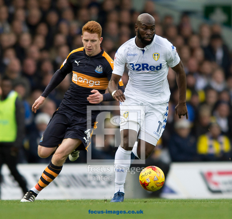 Souleymane Doukara of Leeds United (right) gets past Jack Colback of Newcastle United during the Sky Bet Championship match at Elland Road, Leeds<br /> Picture by Russell Hart/Focus Images Ltd 07791 688 420<br /> 20/11/2016