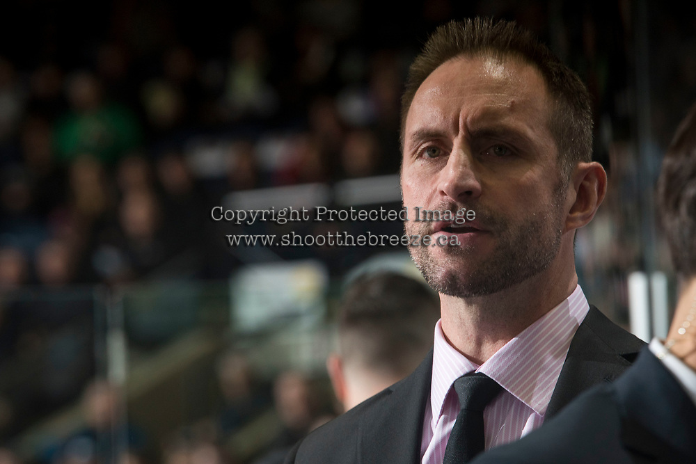 KELOWNA, CANADA - MARCH 24: Kelowna Rockets' head coach, Jason Smith stands on the bench against the Kamloops Blazerson March 24, 2017 at Prospera Place in Kelowna, British Columbia, Canada.  (Photo by Marissa Baecker/Shoot the Breeze)  *** Local Caption ***