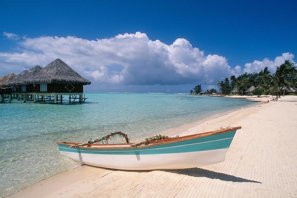 Bora Bora, Tahiti: Intercontinental Le Moana Bora Bora resort bungalows, beach and outrigger canoe..