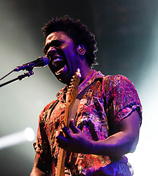 © Licensed to London News Pictures. 22/02/2013. London, UK.   Kele Okereke of  Bloc Party performing live at Earls Court. Bloc Party are a British indie rock band, composed of Kele Okereke (lead vocals, rhythm guitar), Russell Lissack (lead guitar), Gordon Moakes (bass guitar, synths, backing vocals, glockenspiel), and Matt Tong (drums, backing vocals). Photo credit : Richard Isaac/LNP