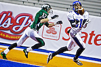 Coeur d'Alene High's Deon Watson gets under a touchdown pass after beating Joe Dlugosch from Eagle into the end zone.