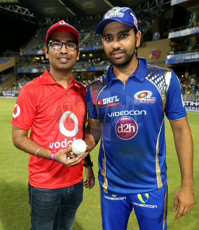 Mumbai Indians captain Rohit Sharma signs the vodafone ball during the presentation of the match 23 of the Pepsi IPL 2015 (Indian Premier League) between The Mumbai Indians and The Sunrisers Hyferabad held at the Wankhede Stadium in Mumbai India on the 25th April 2015.<br /> <br /> Photo by:  Sandeep Shetty / SPORTZPICS / IPL