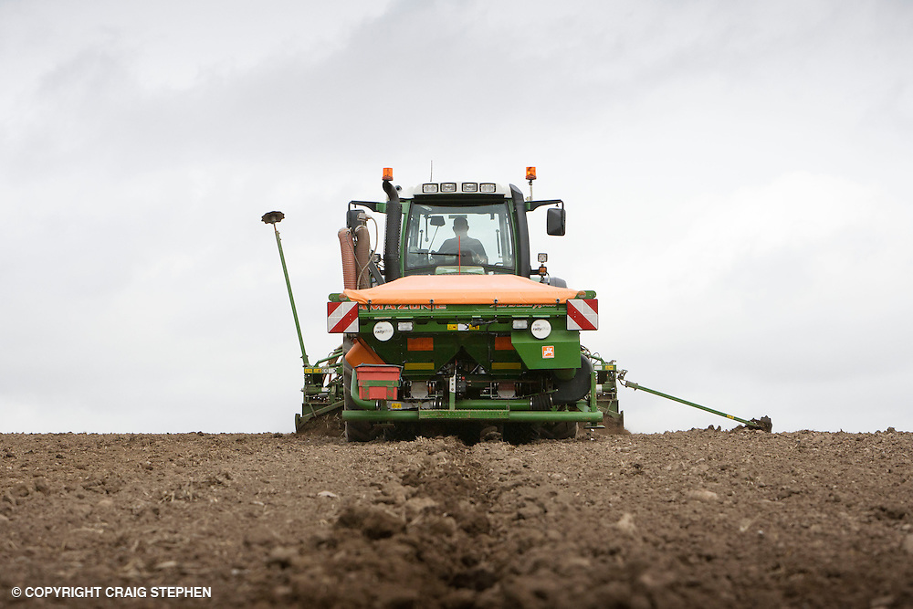 A tractor tilling a field