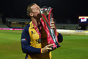 Victorious Captain Simon Harmer kissing the Vitality T20 Blast Trophy during the Vitality T20 Finals Day 2019 match between Worcestershire County Cricket Club and Essex County Cricket Club at Edgbaston, Birmingham, United Kingdom on 21 September 2019.