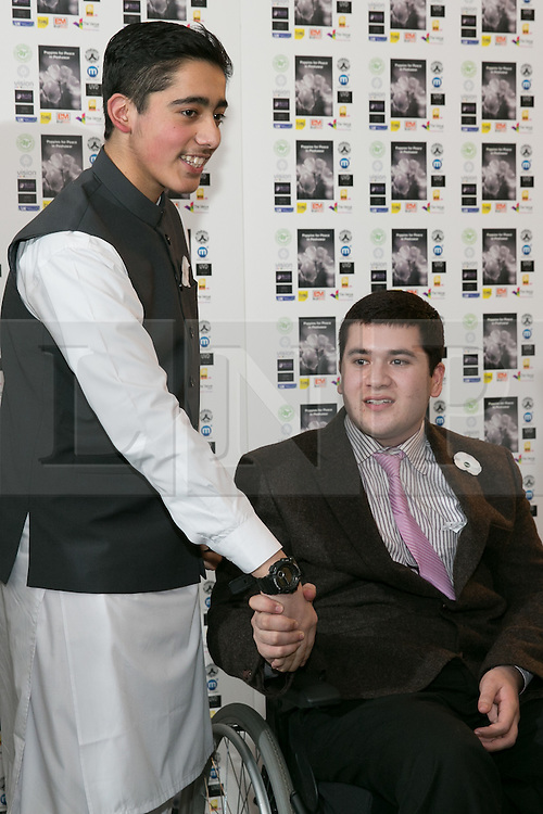 © Licensed to London News Pictures. 15/12/2015. Birmingham, UK. Malala Reception. Pictured, Brothers, Ahmad Nawaz and seated Muhammad Ibrahim. One year on from the tragedy of the Taliban attack on the Army Public School (APS) Peshawar, Nobel Prize winner and teenage activist, Malala Yousafzai and her family hosted a special reception to mark the anniversary of one of the deadliest terrorist attacks in Pakistan.The commemorative reception held today was attended by Ahmad Nawaz and Muhammad Ibrahim Khan, two of the young survivors of the tragedy, along with Malala Yousafzai, the peace and education activist, who has made Birmingham her adopted home. As part of the commemorative ceremony, members of the public are being asked to wear a white poppy, representing the global mark of peace. Photo credit : Dave Warren/LNP